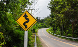 Curvy road sign to the mountain Stock Image