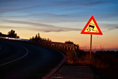 Curvy road sliding danger traffic sign Royalty Free Stock Image