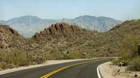 Curvy road through the Sonoran Desert royalty free stock image