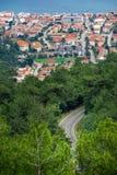 Curvy road between trees. Turunc bay, Marmaris, Turkey. House and sea background royalty free stock photo