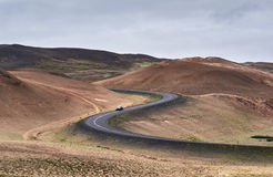 Curvy road trough a vulcanic area. In the north of Iceland Stock Images