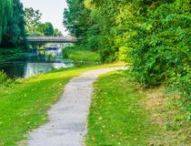 Curvy road with water pond and bridge view stock photo