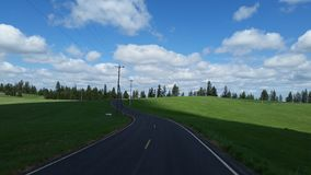 Curvy Road. A curvy road winds it& x27;s way through the countryside stock photography