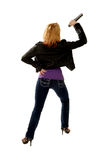 Curvy Rock Star Singing. Rear view of curvy Blond Rock Star singing into microphone Royalty Free Stock Images