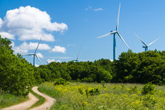 Curvy rural road to wind generators area Royalty Free Stock Photography