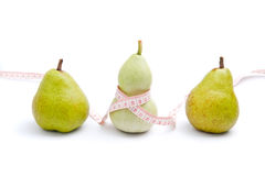 Curvy shaped body. Use trigonella to represent women's curvy shape and pear to represent pear shaped body royalty free stock images