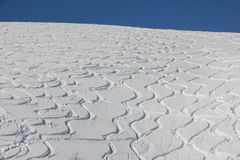 Curvy Ski Tracks In The Snow Royalty Free Stock Images