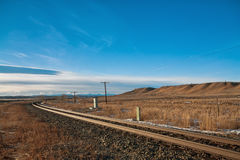 Travelling the Prairies. Curvy train tracks in the prairie Royalty Free Stock Image