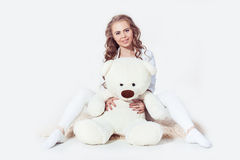 Curvy woman blonde girl hugging teddy bear Stock Photos