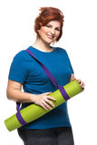 Curvy woman carrying yoga mat. On the white background Royalty Free Stock Image