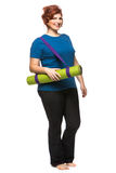Curvy woman carrying yoga mat. On the white background Royalty Free Stock Photo