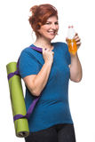 Curvy woman carrying yoga mat. On the white background Royalty Free Stock Images