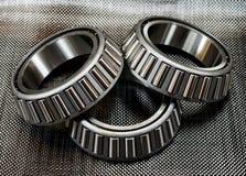3 cuscinetti a rulli affusolati automobilistici sulla fibra del carbonio Immagini Stock