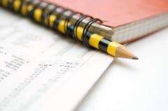 Cuscinetto e matita rossi Fotografia Stock