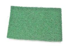 Cuscinetto verde del raschiatore della fibra su fondo bianco Fotografia Stock Libera da Diritti