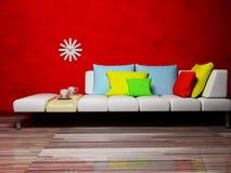Cuscini colorati sul sofà Immagine Stock