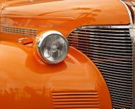Cuscino ammortizzatore arancione di un'automobile antica Immagini Stock