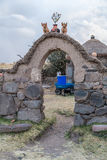 Cusco, Peru - circa June 2015: Stone gate at the Peruvian village in the countryside, Andes Mountains,   Peru Royalty Free Stock Photography