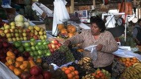 Cusco, Peru- June 20, 2016: a female fruit vendor at the main market in Cusco, Peru