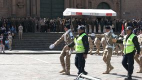 CUSCO, PERU- JUNE 22, 2016: soldiers and security personnel marching in front of the cathedral of cusco