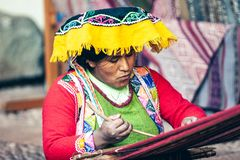 Cusco / Peru - May 26.2008: Portrait of a sewer woman, seamstress at work,. Portrait of a sewer woman, seamstress at work, dressed up in traditional native stock photography