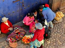Cusco Peru/2nd September 2013/aA group of local people stop in a stock image