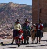 Cusco, Peru/2nd September 2013/Thre older local women holding an royalty free stock photos