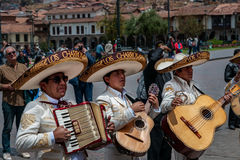 CUSCO, PERU - OCTOBER 7, 2016: Latin musicians in sombrero play guitars and accordion in a wedding.  Royalty Free Stock Photo