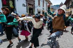 CUSCO, PERU - OCTOBER 7, 2016: Peruvian boys wearing traditional clothes and hats dance in a festive procession. Royalty Free Stock Photography