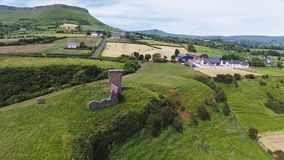 Cushendall Castle and Waterfoot Bay stock images