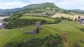 Cushendall Castle and Waterfoot Bay royalty free stock photo