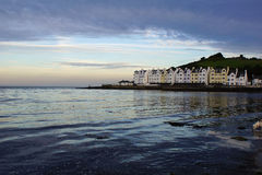 Cushendun Bay in the evening. Sunset in Cushendun, the bay which is on the Irish sea, is calm and peacful. County Antrim, Northern Ireland Royalty Free Stock Photography