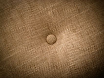 Cushion. Background with fabric texture and button stock photography