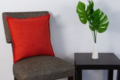 Cushion arranged on chair. Red cushion arranged on chair stock images