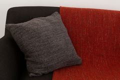 Cushion and blanket arranged on sofa. Close-up of cushion and blanket arranged on sofa stock photography