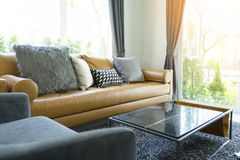 Cushion on brown leather sofa in living room. Luxury cushion on brown leather sofa in modern living room royalty free stock photo