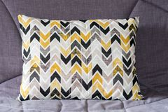 Cushion on the couch. Colorful cushion on the couch grey stock photo