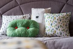 Cushion on the couch. Colorful cushion on the couch grey stock image