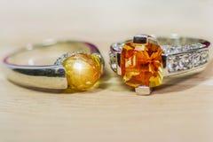 Cushion Cut Citrine Gemstone .yellow orange Round Cut and Diamond Ring.Placed on a beautiful light wood floor. Cushion Cut Citrine Gemstone .yellow orange Round stock images