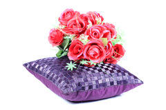 Cushion and flower. Beautiful shot of cushion and flower on white background stock photography