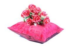Cushion and flowers Stock Photos