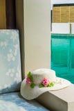 Cushion and hat at balcony. Stock Photo