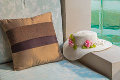 Cushion and hat at balcony poolside. Royalty Free Stock Image