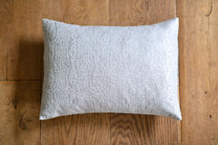 Cushion. Individual textured cushion on a wooden background stock images