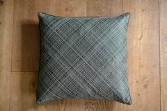 Cushion. Individual textured cushion on a wooden background stock photo
