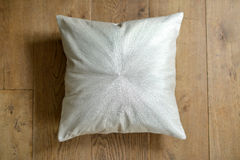 Cushion. Individual textured cushion on a wooden background stock image