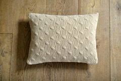 Cushion. Individual textured cushion on a wooden background royalty free stock photos
