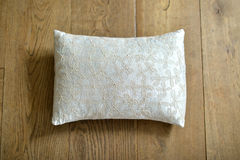 Cushion. Individual textured cushion on a wooden background royalty free stock photo