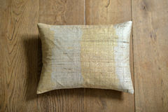 Cushion. Individual textured cushion on a wooden background stock photography