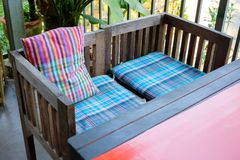 Cushion Seat and Chair in Thai Style. Cushion seat in gingham pattern design on old wood chair, Thai style furniture stock photo
